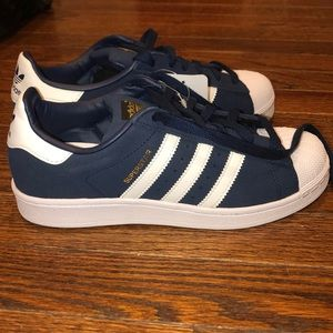 Navy blue adidas superstar sneakers